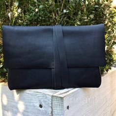 Black leather wrap envelope clutch
