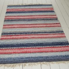 A great rug! Unusually wide and made from rich blues and reds. In good condition. 100% Cotton. Dry cleaning recommended.