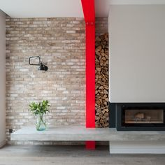 The overhanging concrete plinth acts as a hearth or, as Tigg imagines it, a sort of contemporary inglenook. Wood piles neatly between the beam and wall. The fireplace, a Stovax Riva is flanked by a Lampe Gras wall lamp. Cantilever Architecture, Interior Architecture, London Architecture, Colorful Decor, Colorful Interiors, Living Room Decor Colors, Interior House Colors, Interior Design, Up House