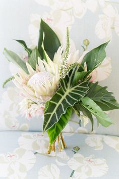Photography: http://amalieorrangephotography.com | Floral design: http://larasthemes.com/ | Read More: https://www.stylemepretty.com/2018/01/18/modern-tropical-vero-beach-wedding/