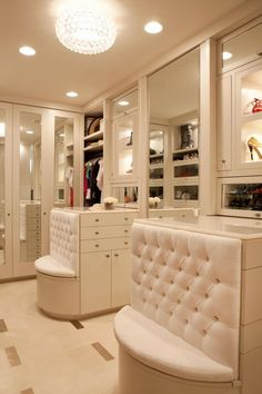 This is pretty much my dream closet. Mirrored closet doors, short bureaus for jewellery and undergarments, plus swanky white tufted velvet banquette seats for sitting and putting on shoes. More than one seat means you can play dress up or put on a fashion show with your daughters or grown-up girlfriends. Love it!!