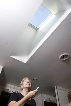 Skylights in living room flat ceiling with attic for Velux sun tunnel installation manual