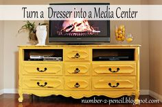 Old dresser becomes a media center.  What a fantastic idea ... love the look and that yellow!!!