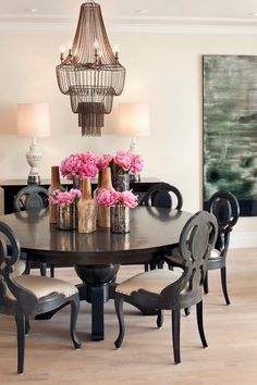 Black dining table ornate chairs