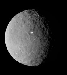 What's the spot on World Ceres?  Can you guess what's creating those unusual bright spots on Ceres? On March 6, NASA's Dawn spacecraft began orbiting Ceres, the largest body in the main asteroid belt between Mars and Jupiter. Even before the spacecraft arrived at the dwarf planet, images revealed mysterious bright spots that captivated scientists and observers alike. Until Dawn gets a closer look over the next few months, it's anyone's guess what those spots could be.