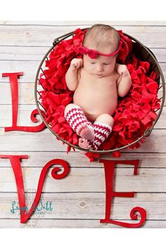 1. basket  2. red shag blanket 3. curly wood letters (L,V & E) 4. Red crochet hair bow 5. Red & White crochet leg warmers