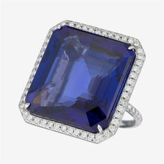 A tanzanite, diamond and platinum ring centering a square step-cut tanzanite weighing approximately: 52.35 carats; in a full-cut diamond mounting and shank; total diamond weight approximately: 0.95 carat #FreemansAuction