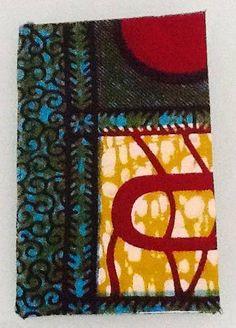 Notez, dessinez, brillez au bureau, à la maison ou sur les bancs de l'école avec ce beau carnet à petits carreaux aux couleurs africaines