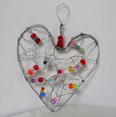 Wire and bead heart via: The Art Annex