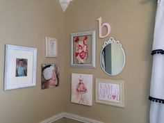 Fun gallery wall - we think the framed vintage bathing suit is just an adorable touch!