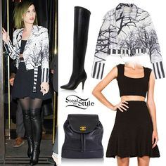 Katy Perry stepped out in London yesterday wearing a Mary Katrantzou Purple Zen Leather Biker Jacket , a black RVN Chevron 3D Jacquard Crop Top and matching RVN Chevron 3D Jacquard Flare Skirt, boots similar to the Dune Stretchy Leather Round Toe Stiletto High Boots, and a vintage Chanel Black Caviar Skin Logo Backpack. #KatyPerry #Outfit