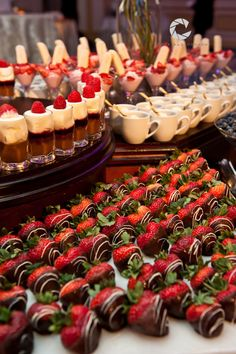 Chocolate covered strawberries and desserts on display, presentation only.
