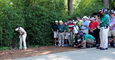 Phil Mickelson looks for his ball in the woods on the fourth hole during Sunday's final round of the 2012 Masters Tournament at Augusta National Golf Club on April 8, 2012, in Augusta, Ga. (Jackie Ricciardi/Staff)