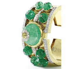 18 Karat Gold, Platinum, Emerald, Colored Diamond and Diamond 'Vegas' Cuff-Bracelet, David Webb. Centering a fluted emerald, centered by a round diamond of yellow hue, flanked by eight smaller carved emeralds, accented by round diamonds weighing approximately 4.80 carats.