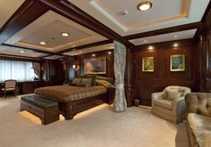 One of the spacious bedrooms aboard the 60.1m luxury motor yacht Paraffin