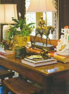 equestrian lamp, tole pot, books, potted plant in beautiful brass cache pot, stools.all of it is just timeless. English Country Manor, English Style, Equestrian Decor, Equestrian Style, Estilo Colonial, British Colonial Style, English Decor, French Country Decorating, Home Accents