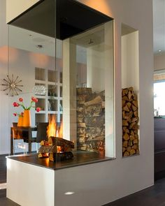 I'm typically more traditional when it comes to decor, but I kinda like this modern fireplace.