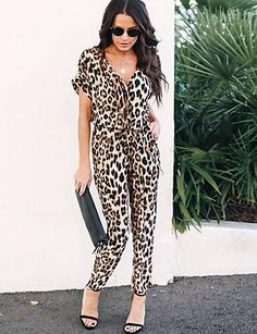 Walk on the wild side in this leopard jumpsuit! It's a chic style with short sleeves and a V-neck. It's gorgeous in the city and on the beach!