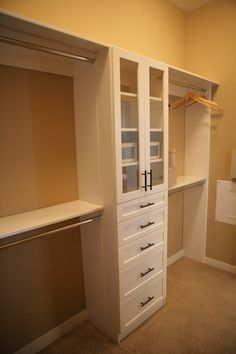 "(Res 1) OPTIONAL CLOSET ORGANIZER - We feature an optional ""deluxe"" closet organizer system in white finish at the master closet in this model residence. #LyonAgave #newhomes"