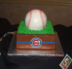 "Cubs Baseball Groom's Cake - All bc, with 10"" square cake below ball pan cake. The Cubs logo on the front was hand painted on a cutout circle of white modeling chocolate. I was happy w/ how this turned out."