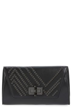 Obsessed with this glamorous leather clutch from Diane von Furstenberg. It's the perfect partner for any ensemble!