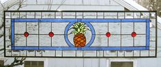 Pineapple Transom -10.5 x 34.5--Stained Glass Window Panel  The is a new design featuring a Pineapple in a transom panel. The fruit symbolizes those intangible assets we appreciate in a home: warmth, welcome, friendship and hospitality. The panel measures 10.5 x 34.5 and has 3/8 zinc came for the frame around it. The background for the panel will be clear textured water glass . The border is 1.5 wide beveled glass in lengths that correspond closely to the concept photo. It has a black patina…