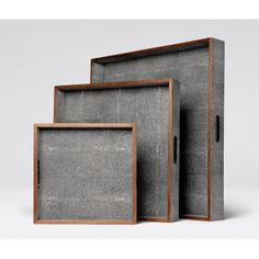 Faux shagreen trays with wood trim. Sold as a set of 3.  www.madegoods.com