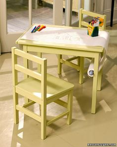 DIY instructions on how to create kids craft table with paper roll. Additional idea: Paint table top with chalkboard paint so can use chalk too