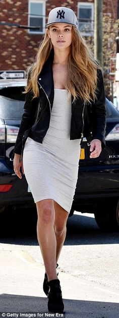 Sidewalk superstar: Another look saw Nina highlight her hour-glass bodyshape in a bodycon jersey dress as she strutted down the street in a pair of heeled shoe-boots