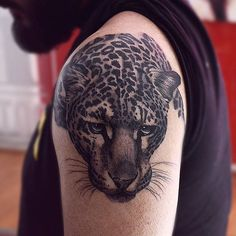 Black and grey style leopard tattoo.