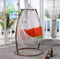 Furniture, Elegant White Rattan Swingasan Chair With Orange Cushion:  Enchanting Swingasan Chair Ideas