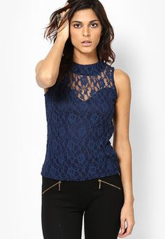 Navy Blue Embroidered Blouse Keep your look lively wearing this navy blue coloured top from the house of Liebemode. This top is designed as per the latest trends and fashioned using quality nylon blend. Designed to perfection, this classy top will look great when clubbed with trousers and black pumps. http://m.jabong.com/liebemode-Navy-Blue-Embroidered-Blouse-561928.html