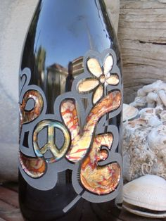 Detail Image of Love & Peace design on Re-purposed wine bottle that transforms into oil lamps