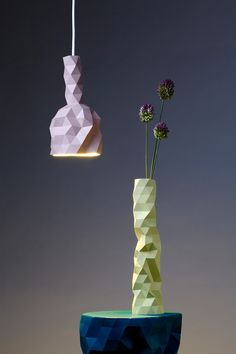 The FACETURE series consists of handmade faceted vessels, light-shades and a table. The idea behind them is simple but effective. Each object is produced individually by casting a water-based resin into a simple handmade mould. Origami, Modern Spaces, Light Shades, Decorative Objects, A Table, Vases, Designer, Furniture Design, Nice Furniture