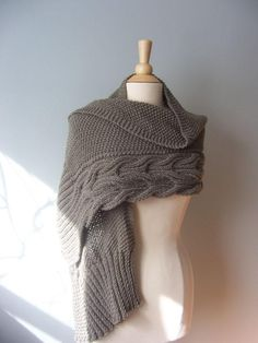 The is a reversible cabled wrap of my own design. Which means that no matter how you put it on the cable will look beautiful. Warm but yet a versatile piece. It can be worn as a wrap, a shawl or a a scarf. A classic that will surely hold the test of time.