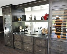 Custom wine bar: wet bar, sink, wine coolers, mirrored back and lots of drawer space make this functional and attractive for any executive home. moda kitchens & cabinets, Calgary