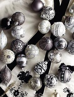 Dress your Christmas tree in elegant Hollywood elegance with the 60-pc. Regency  Ornament Collection that boasts a stunning array of teardrop, globe and finial designs embellished with faux pearls, crystals beads, ribbon and hand painted details.