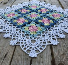 Continues to crochet flower squares, made some small adjustment on the edge this time. Love the printed colors Yarn: järbo from Hook: Design Crochet Afgans, Crochet Quilt, Crochet Tablecloth, Crochet Home, Crochet Motif, Crochet Doilies, Crochet Stitch, Crochet Flower Squares, Granny Square Crochet Pattern