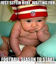 Cutest+baby+sitting+in+front+of+the+TV+and+wearing+an+NFL+hat+and+looking+very+bored+and+tired+of+waiting+for+the+new+season+to+start.