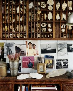 In a curiosity tray, designer India Hicks displays a collection of seashells at her home in the Bahamas. Its formality contrasts elegantly with the casual pinnings of postcards and inspiration photos. Each detail was chosen with care, and the effect feels personal.