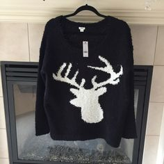 New soft black deer sweater by garage large New with tags was a gift but too small for me purchased at a new store called the garage Garage Sweaters Crew & Scoop Necks