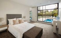 Bedroom in Contemporary Style Home by Domoney Architecture