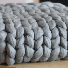 Knitted merino blanket in gray colour. This chunky blanket is unique because has been handmade and prepared from the merino wool. Chunky Blanket, Merino Wool Blanket, Blankets, Gray, Handmade, Color, Trapillo, Grey, Hand Made