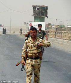 Kurdish Peshmerga forces deploy their troops on the outskirts of the multi-ethnic Iraqi ci...