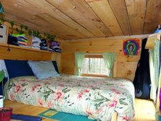 Plenty of headroom in the loft, with storage shelves neatly arranged.  #TinyHouseforUs