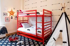 Interior designer Lauren Behfarin turned this Upper East Side kids' bedroom into a creative play space that can evolve as the kids get older. Features include bunk beds, wall decals, a playful rug and a teepee.
