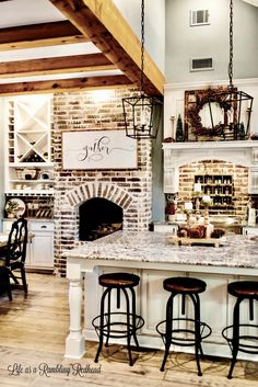 Love all this brick and rustic wood in the kitchen!