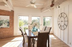 A formal dining room welcomes in the morning sun with expansive windows and vaulted ceiling.