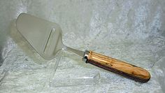 Stainless cheese plane with handle turned from spalted maple and stratabond.
