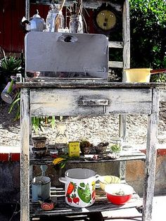 Mud Pie kitchen, inspiration for backyard activity needs a bit of planning but goodwill and some trash picking, easy.